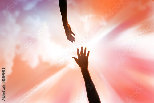 religious arm of human held up high in the sky to ask for rescue and forgiveness Fototapete