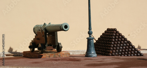 Fotografie, Obraz Horizontal shot of a cannon and cannon balls near Royal Palace in Monaco
