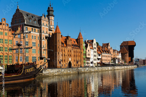 Leinwand Poster Motlawa river embankment in historical part of Gdansk at sunny day, Poland