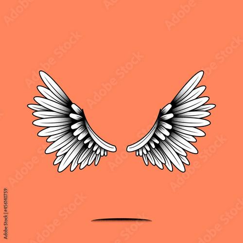 Fototapeta premium Pair of wings element on an orange background vector