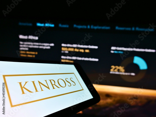 Fototapeta premium STUTTGART, GERMANY - Mar 05, 2021: Cellphone with logo of Canadian mining company Kinross Gold Corp. on screen in front of webpage.