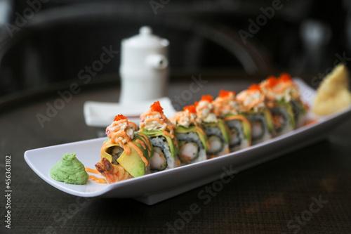 Fototapeta Delicious shrimp avocado sushi roll on a plate