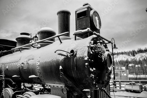 Fotografie, Obraz Snow on an old steam locomotive during winter in northern Canada