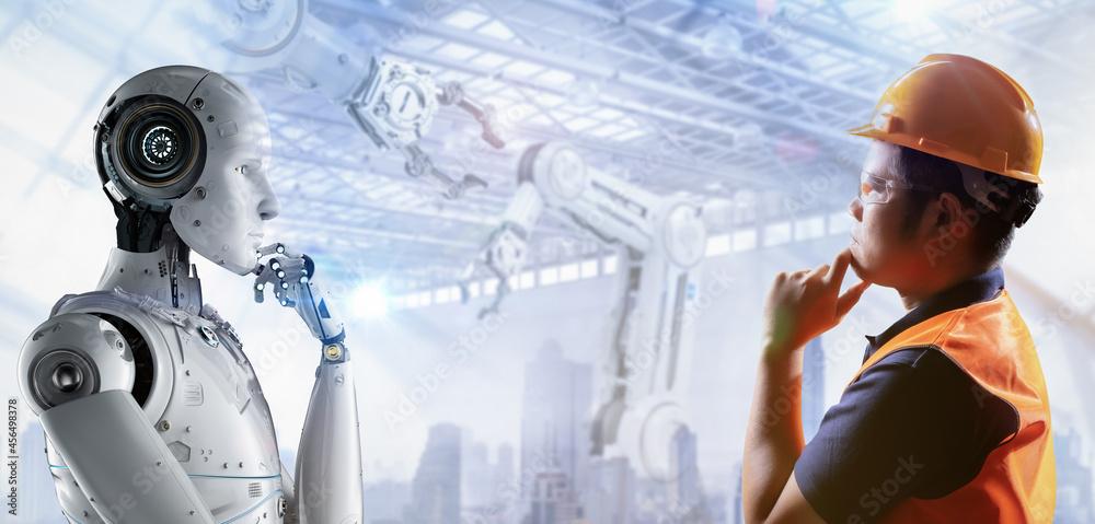 Leinwandbild Motiv - phonlamaiphoto : Technician or engineer work with robot in factory