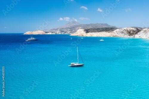 Obraz na plátně An aerial view of the yacht on the azure sea