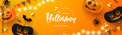 Fotografie, Obraz Happy Halloween background with glowing pumpkins, candy, bat, flags and spiders