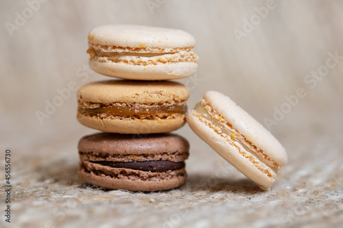 Fototapeta french Colorful Macarons close up Colorful Pastel Macarons on beige Background B