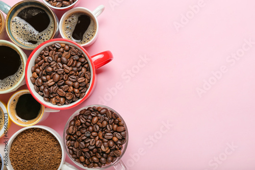 Slika na platnu Different cups with coffee and beans on color background, closeup