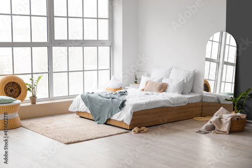 Interior of modern bedroom with mirror