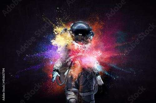 Fototapeta Astronaut in suit against black background