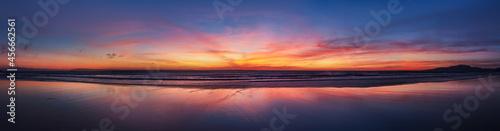 Fotografering Panorama sunset ocean beach of Spain city Tarifa Andalusia