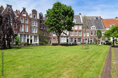 Fotografie, Obraz Historic houses in the Begijnhof, one of the oldest courtyards (hofjes) in Amsterdam