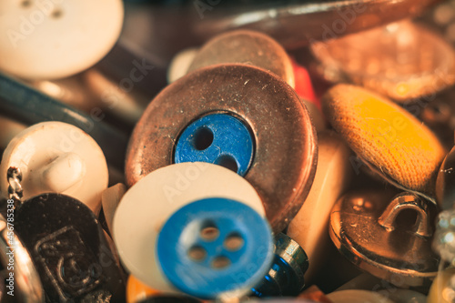 Selective focus shot of colorful buttons of different sizes and sewing materials Fototapet