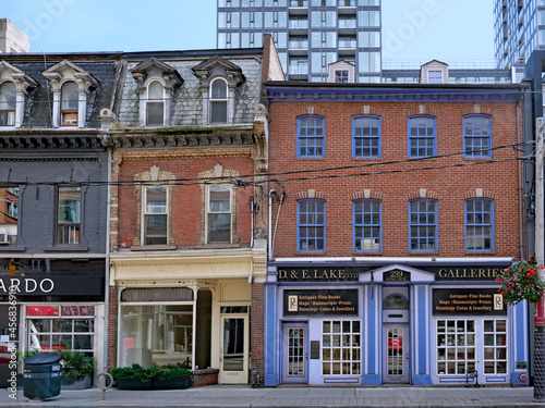 Fototapeta premium Toronto, Canada - September 13, 2021: King Street East is the oldest part of Toronto, and preserves historic commercial buildings, such as these from the 1870s