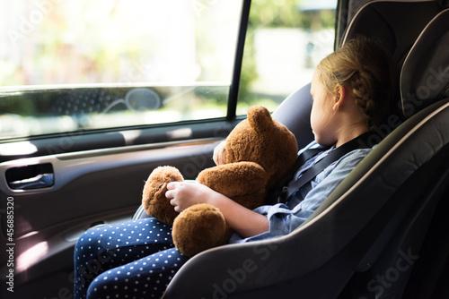 Fototapeta A little girl in a car seat