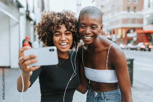 Obraz na plátne Cute girls making a video call