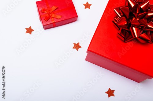 Composition of red presents with stars and copy space on white background
