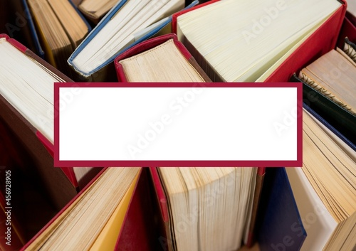 White banner with copy space against multiple books in background