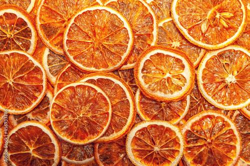 Fotografiet Background created from dry orange slices in random order.