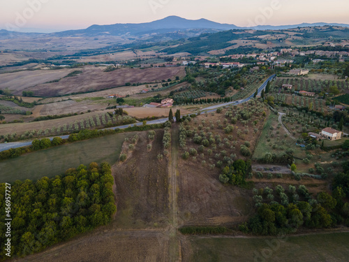 Fototapeta premium Aerial view of a road crossing the rolling hills in Val d'Orcia, Tuscany, Italy.