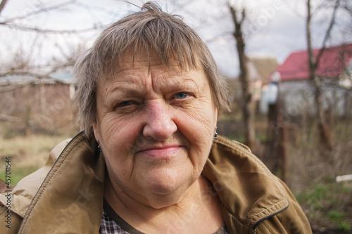 Fotografia, Obraz Elderly Caucasian woman looking at camera. Close-up