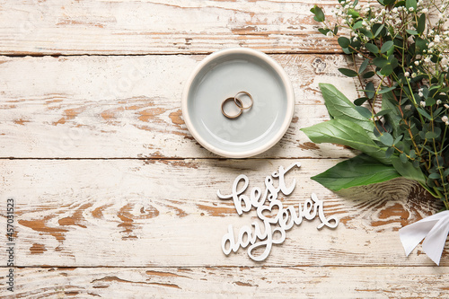 Valokuva Tray with wedding rings, bouquet of flowers and text BEST DAY EVER on white wood