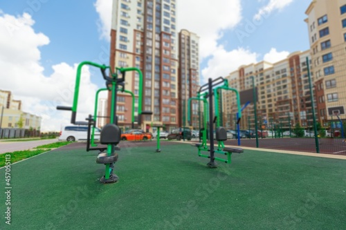 Fotografie, Obraz City courtyard or street with cars and playgrounds for children and walks