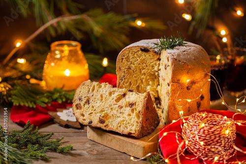 Obraz na plátně Traditional Italian Christmas cake Panettone with festive decorations