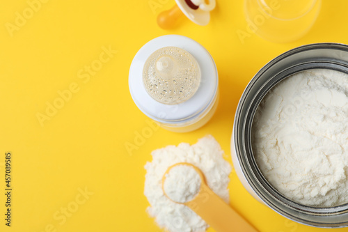 Obraz na plátně Flat lay composition with powdered infant formula on yellow background, space for text