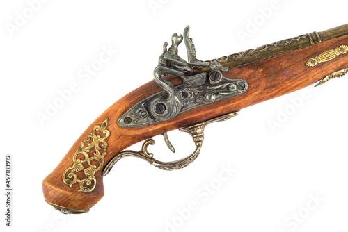 Obraz na plátně Antique pistol inlaid handle and trigger mechanism.