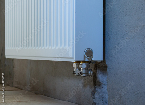 Canvas Print A steel radiator without a tap hangs on the wall