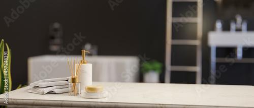 Billede på lærred Marble tabletop with soap, ceramic shampoo bottle, towels and empty space over l