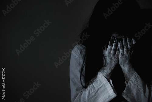 Wallpaper Mural Woman ghost horror sitting crying and have her hands close the face, halloween c