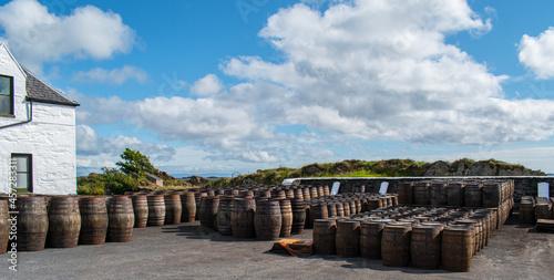 Fototapeta Casks and Barrels in a Whiskey distillery Islay in Scotland coast casks and barr