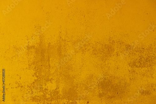 Tela fond ou texture d'arrière plan abstrait jaune, or, mur peint coloré
