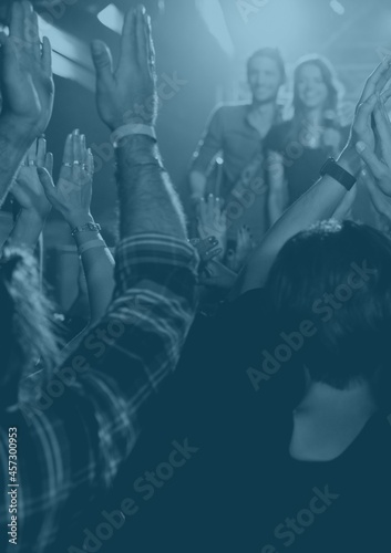 Blue overlay over group of people enjoying at a music concert
