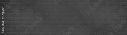 Foto Black anthracite gray grey damaged rustic brick wall brickwork stonework masonry texture background banner panorama