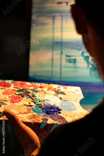 young boy taking a color palette