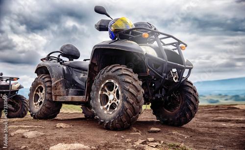 Fotografiet ATV quad bike on forest offroad, summer travel rally