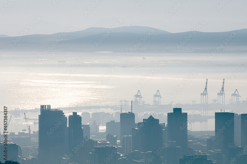 General view of cityscape with multiple modern buildings and scanes in the foggy morning
