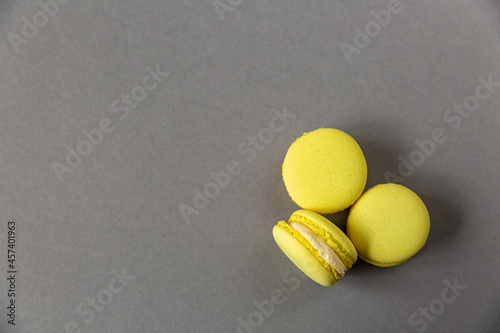 Yellow macarons on a gray background