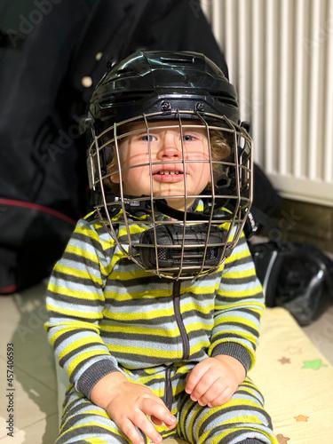 boy wearing a hockey helmet, free seat