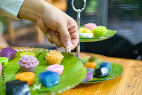 Billede på lærred Thai Chef's hand is decorating Varieties traditional colorful Thai desserts set