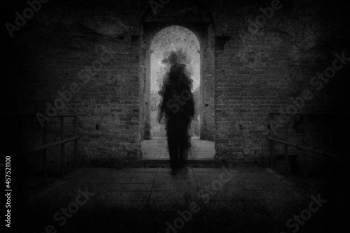 Billede på lærred A spooky ghost, walking towards the camera, framed by the archway of an old building