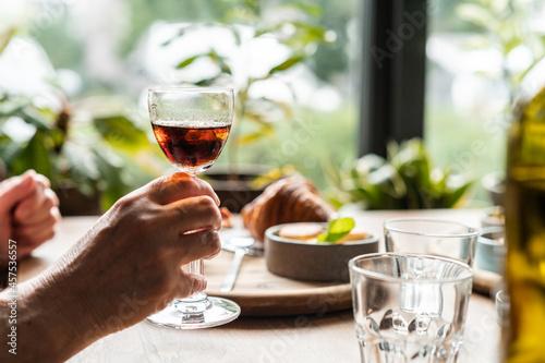 Fotografie, Obraz Holding glass with sherry wine