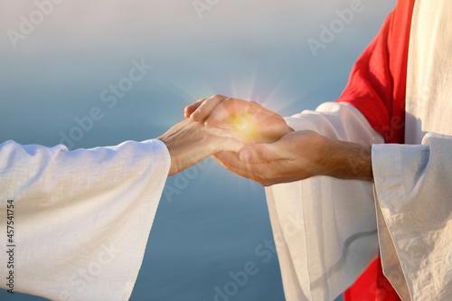 Obraz na plátně Jesus Christ and woman near water outdoors, closeup
