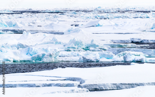 Fotografering Pack ice, icebergs and ice floes of the arctic sea, north of Svalbard