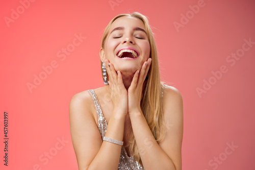 Fotografiet Waist-up joyful accomplished charming rich blond woman in silver stylish evening