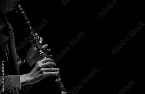 Tela Abstact, Blur hand musician playing on clarinet, Black background