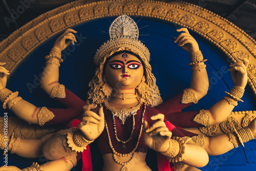 Canvas Print Close up of yellow colour Durga goddess idol with red clothing newly made at a workshop for the religious hindu festival